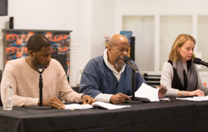 Theater Of War Preview Image of 3 Actors Reading from a Table